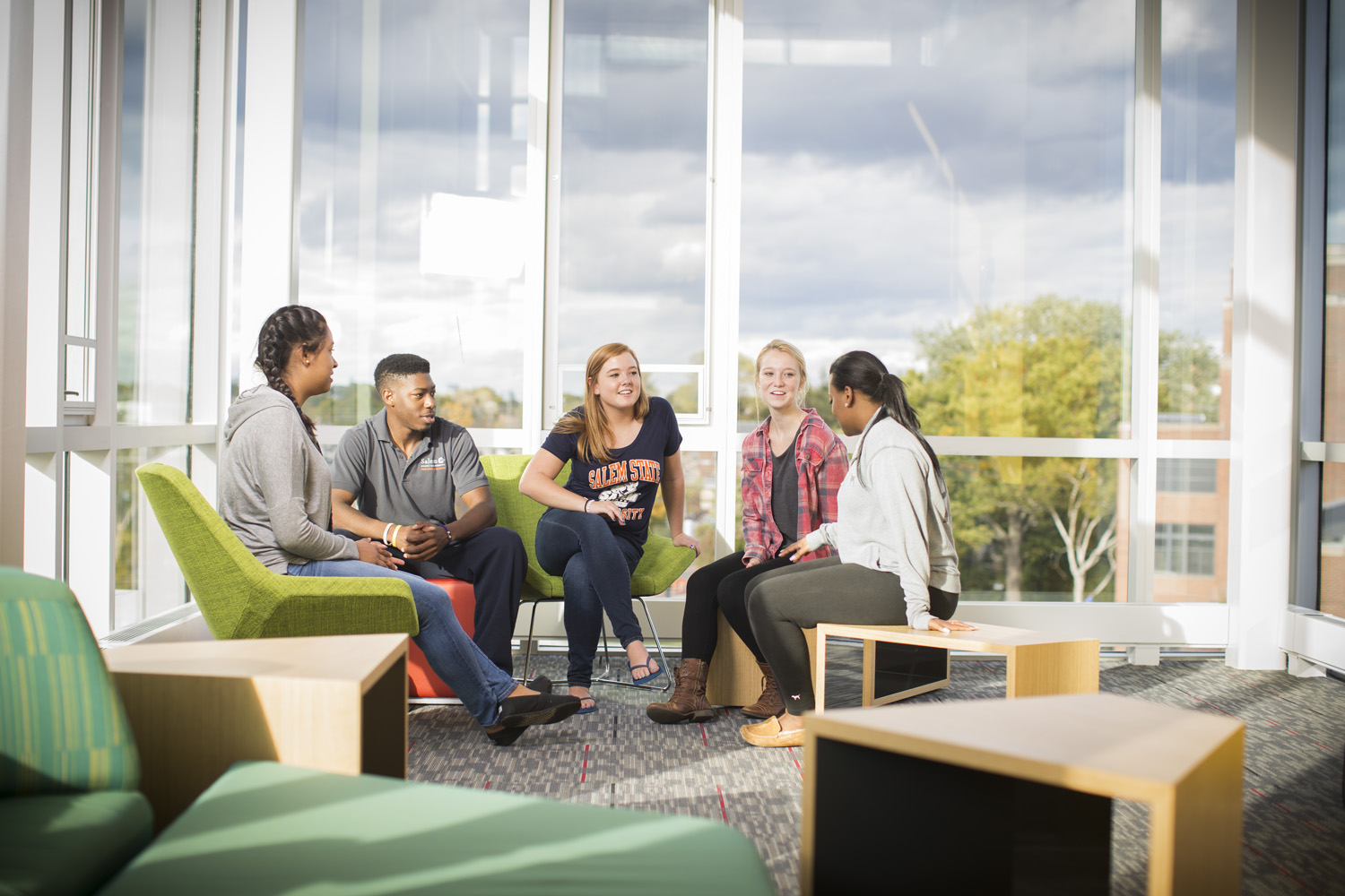 Students together in a common area chatting.