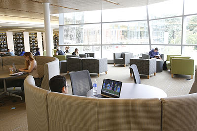 Salem State Berry Library second floor with students studying in modern, light-filled space