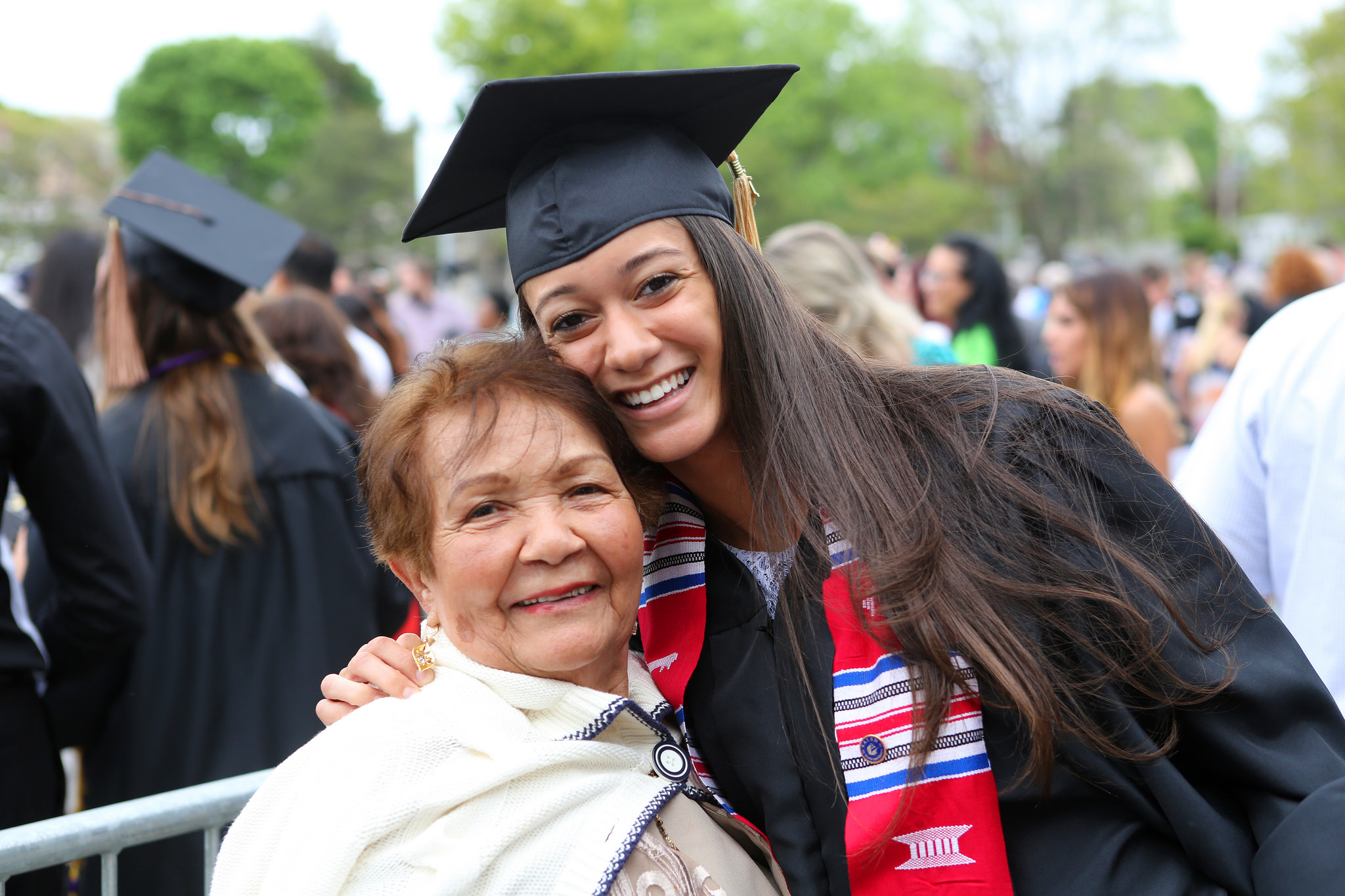 A Salem State graduate poses with a family member