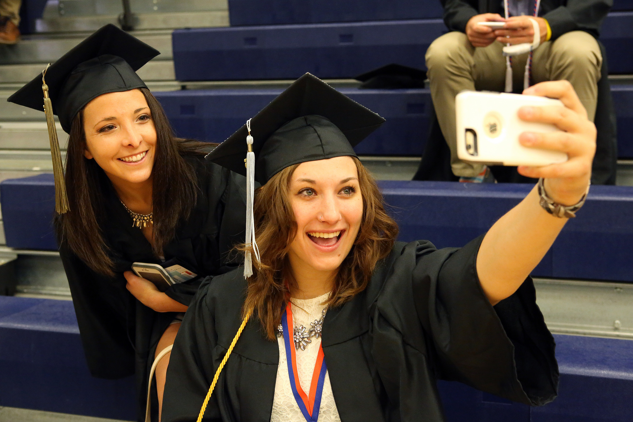 Salem State graduates take a selfie before the ceremony