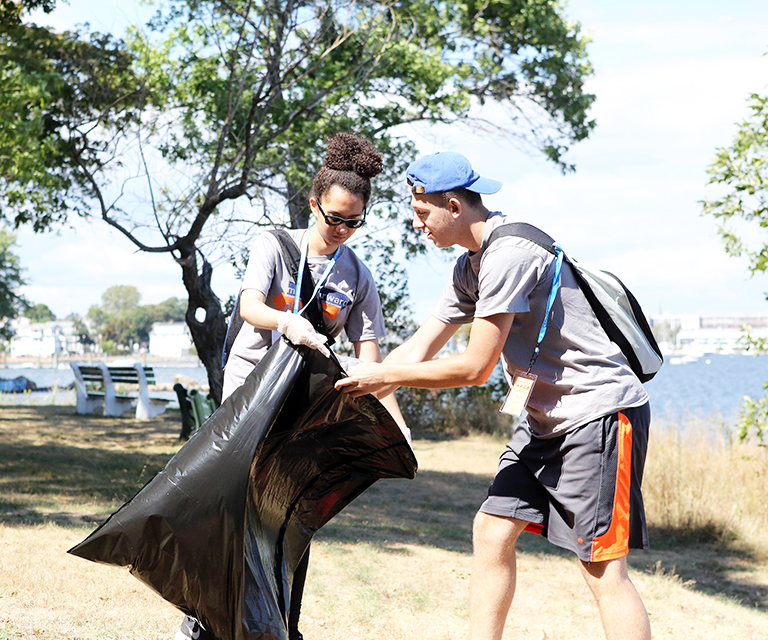 Civic Engagement First Day of Service freshman students cleaning-up Forest River Park