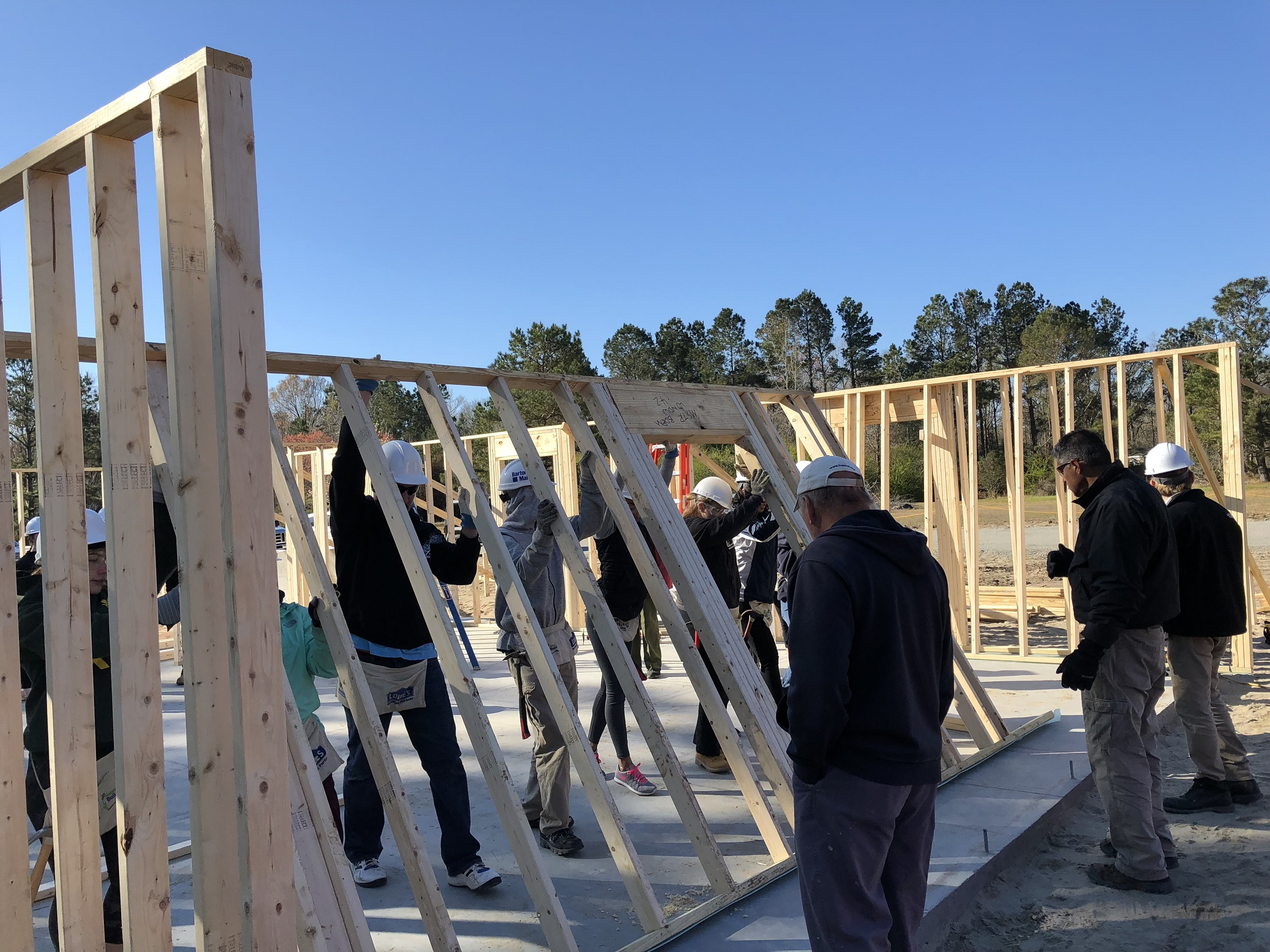 Student volunteers help put together a Habitat for Humanity house