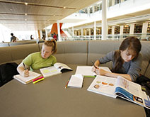 Two female students study in the Berry Library