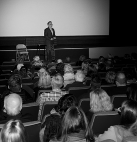Journalist Andrew Rosenthal speaking to an auditorium audience