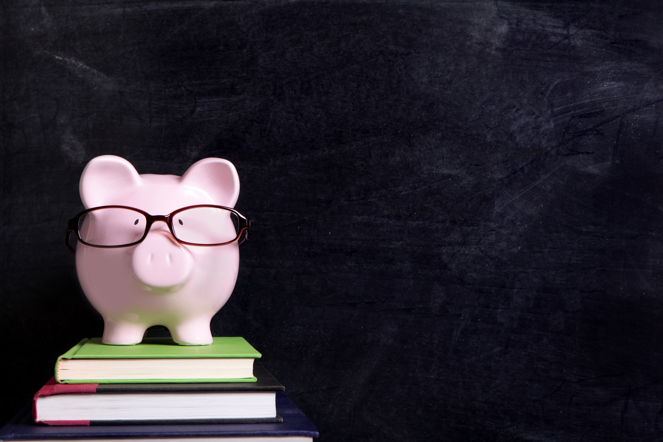 Piggy bank on textbooks