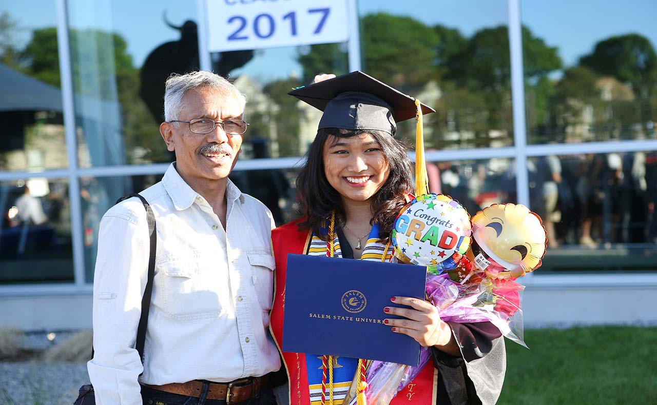 Student poses with her father at commencement