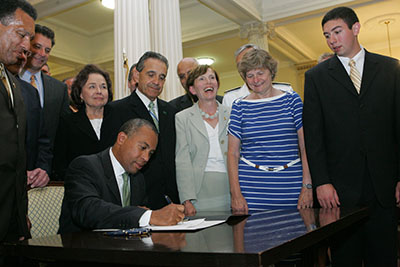 Gov. Patrick with President Meservey and others signs legislation that makes Salem State a university