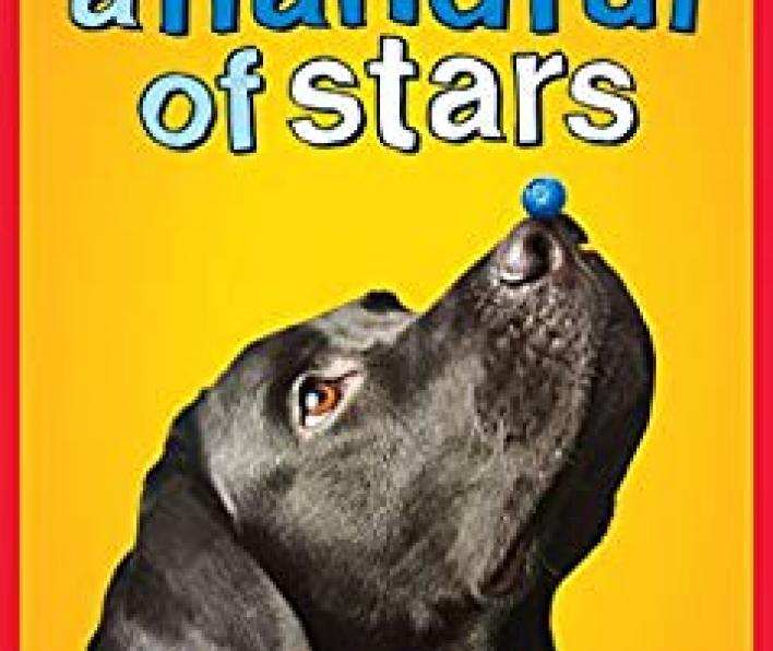 Cover image: Cynthia Lord is in blue capital letters centered on the top. Beneath is Newbury Honor Author of Rules. Beneath that, in a larger cartoon font a handful of stars. Below the title is a photograph of a black lab with its nose in the air. A blueberry is balanced on the tip of its nose. Below that is the word Scholastic.