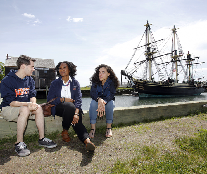 Students in front of FRIENDSHIP in Salem Harbor