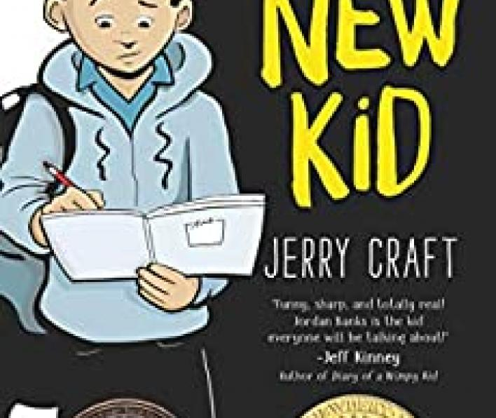 The left third of the cover is a white background and the right two thirds is black. There is a cartoon drawing of a boy wearing a grey hoodie over a blue collared shirt, carrying a backpack, and writing in a journal. He is wearing black track pants. On the black side of the cover are the words: Middle School is hard enough without being the... Then in larger, yellow letters it says New Kid. Below that is Jerry Craft.