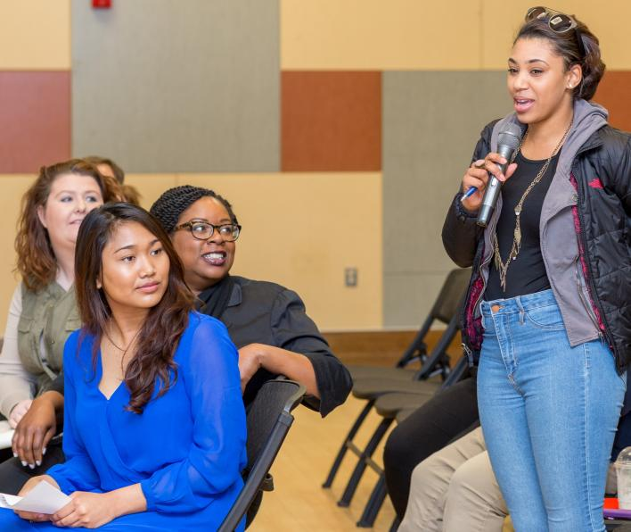 Student and community members ask question of Boston City Councilor Michelle Wu about challenges facing communities in the city of Boston during a 2017 public event.