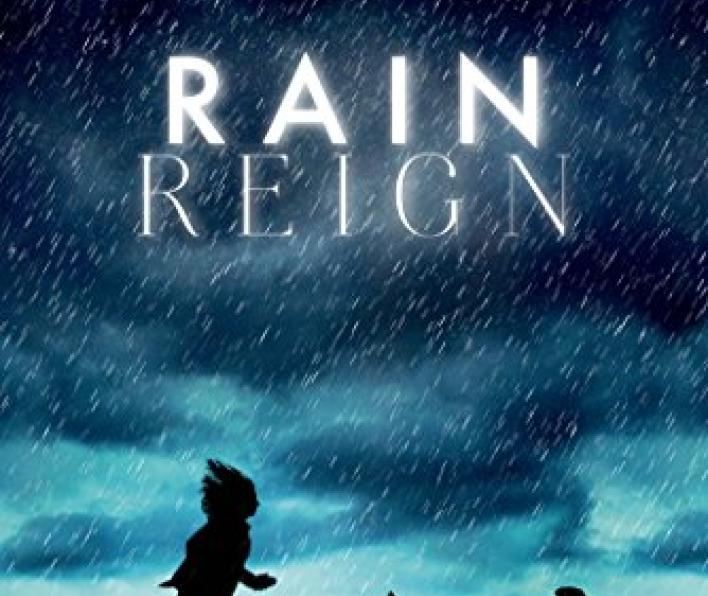 Cover image is of a deep, dark blue sky that lightens as it nears the ground. Rain is pouring down on the silhouette of a girl and a dog running across grass. The next says Newbury Honor Author Ann M. Martin and below in bright white in a bold font in RAIN. Centered below that in a thin white font is REIGN.