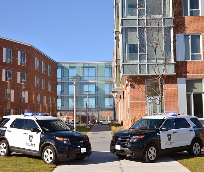 Two police cars parked in front of Viking Hall.