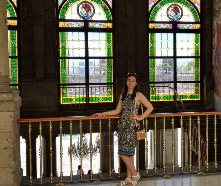 Irune Aparicio in front of stained glass windows
