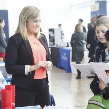A recruiter talks with students about career opportunities.