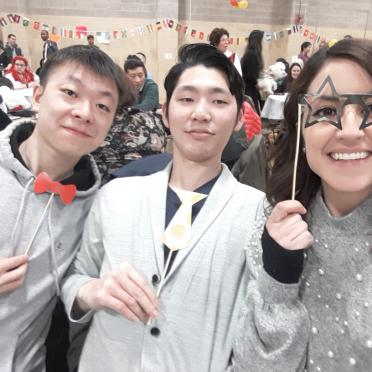 Three Salem State Students hold up party favors at an event