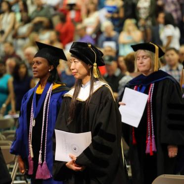 Salem State faculty members process into the commencement ceremony