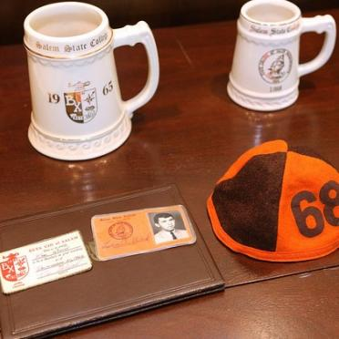 Alumni Weekend 50th Reunion photo of class mugs, beanie and fraternity membership cards 1968