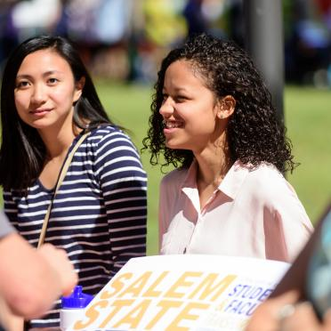 Two students on the library quad at the student activities fair