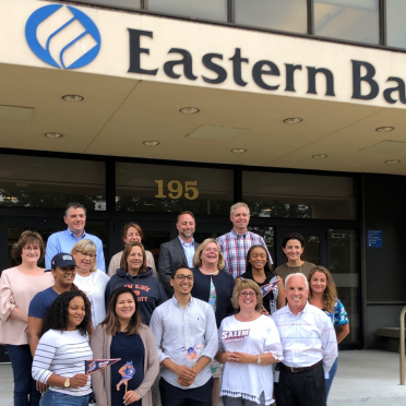 Eastern bank alumni outside of their workplace, Eastern Bank