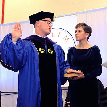 President John D. Keenan takes the oath during his inauguration