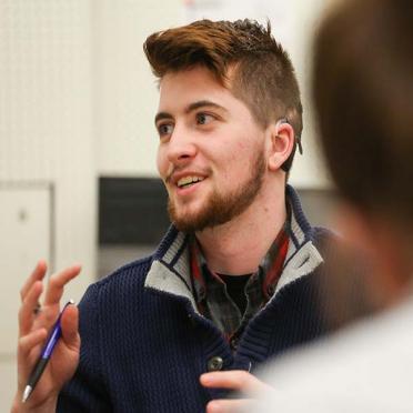 A male graduate student speaking in class