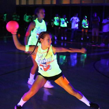 Woman playing blacklight dodgeball