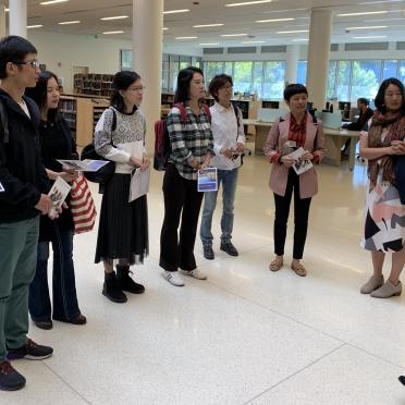 Visiting Scholar Institute (VISI) in the Salem State library learning about the campus