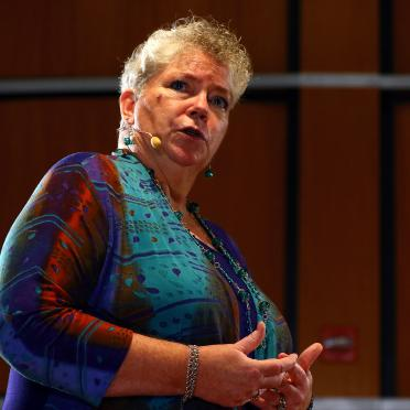 "Political Science Professor Elizabeth Coughlan presents at the 2018 TEDxSalemStateUniversity presentation called ""Bringing Hospitality to Political Discussions"""