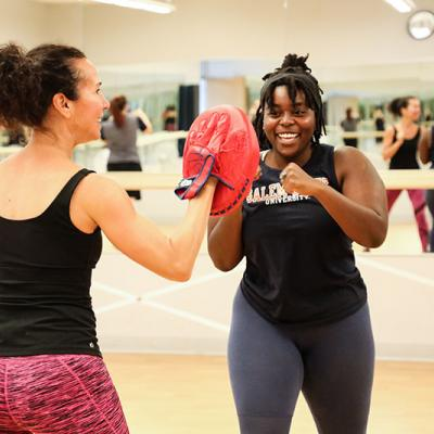 Two young women doing a boxing drill