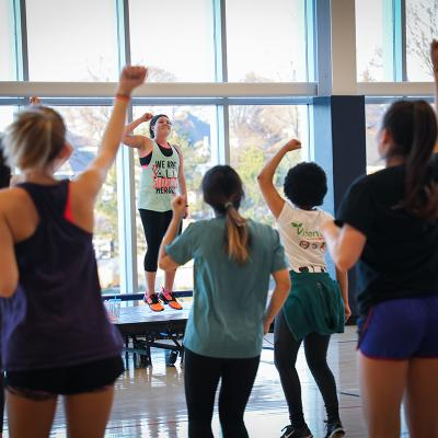 Students at a Zumba class in the gym