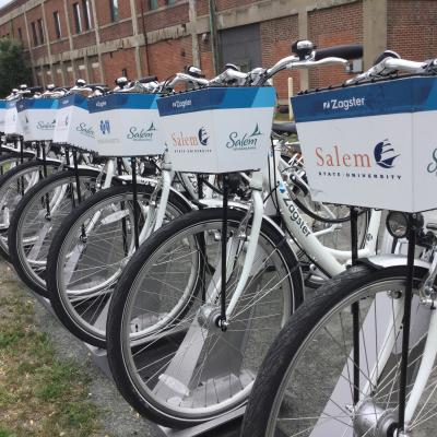 Salem State Zagster bicycles on a rack