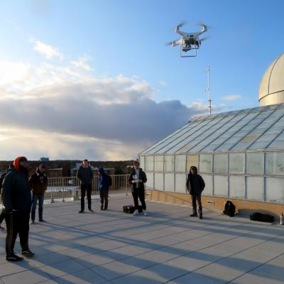 Students working with drones on the roof of Meier Hall