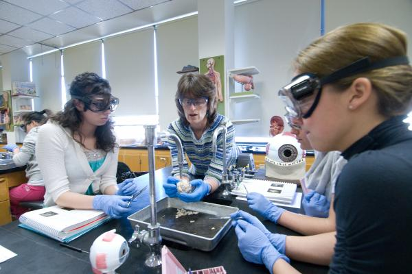 faculty with students in science lab