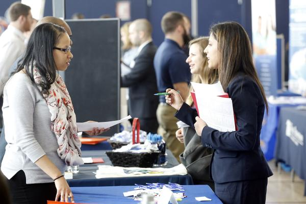 Two women speaking at the Salem State Career Fair.