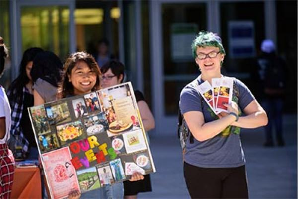 Students stand in front of the Ellison Campus Center at the Student Involvement Fair.
