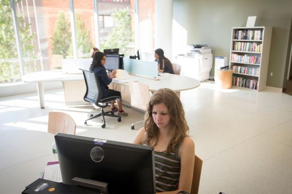 students at library computers