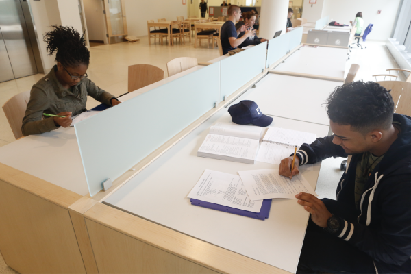 A student is tutored at the Center for Academic Excellence.