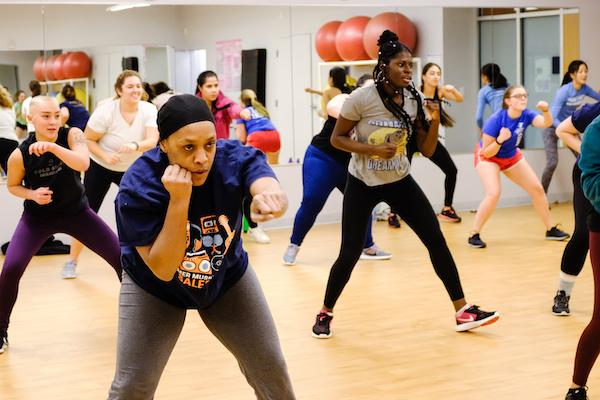 A group of students in a boxing class in the fitness studio