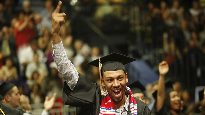 "A student celebrates at commencement by pointing ""I'm number 1"""
