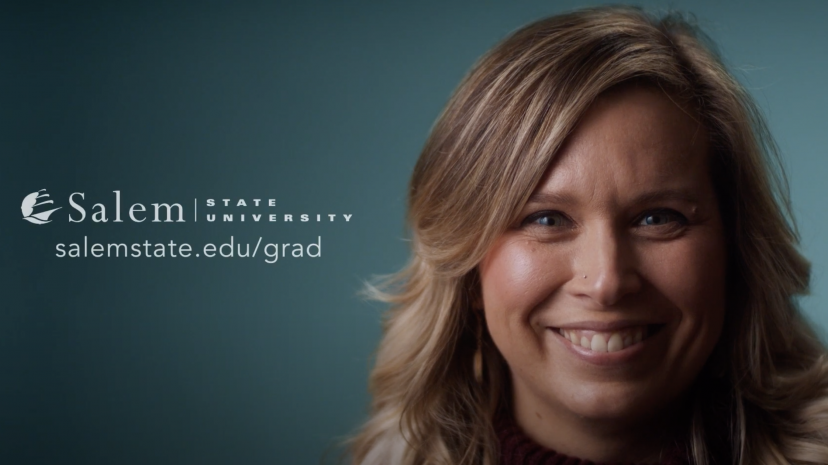 A graduate student smiling with salemstate.edu/grad caption